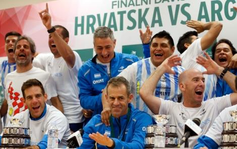 Argentina's Juan Martin Del Potro, bottom left, and the team captain Daniel Orsanic, center, celebrate their victory in the Davis Cup finals, at the news conference in Zagreb, Croatia, Sunday, Nov. 27, 2016. (AP Photo/Darko Bandic) Croatia Tennis Davis Cup Argentina